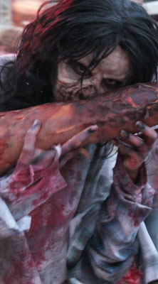 Gruesome Zombie Eating Arm